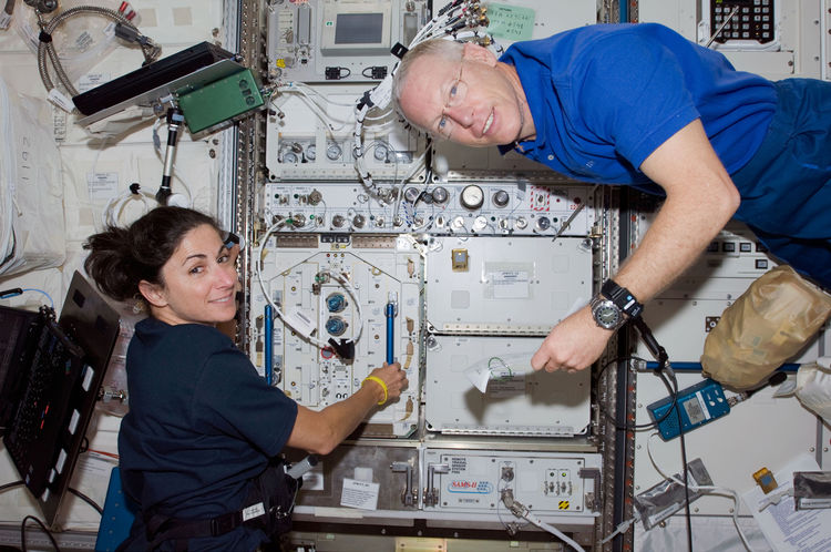 Astronauts Nicole Stott, Expedition 20 flight engineer; and Patrick Forrester, STS-128 mission specialist, work in the Kibo laboratory of the ISS while Space Shuttle Discovery remains docked to the station. Photo taken August 31, 2009. <br /><br />Courtes