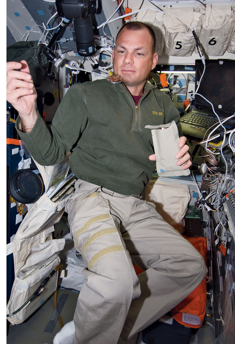 Dinner, however, has fewer rules and playing with food is permissible, as Tony Antonelli displays. Image courtesy of NASA.