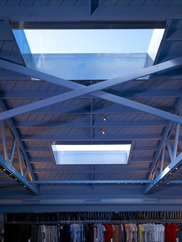 """Skylights afford much of the lighting, though the exposed trusses and cool hues give the shop a delightfully industrial feel. Photograph by <a href=""""http://www.johnlindenphotographs.com/"""">John Linden</a>."""