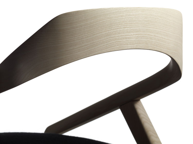 A detail shot illustrates the delicate arching back of the Antelope chair by Monica Förster for Swedese.