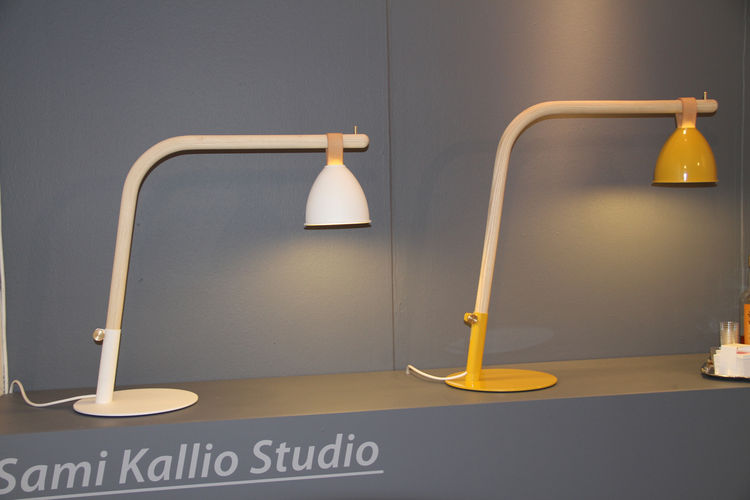 "We end with another student work—Workshop by Finnish designer  <a href=""http://cargocollective.com/SamiKallioStudio"">Sami Kallio</a>. The lamp is of seemingly simple construction, with an aluminum shade that moves along the bent-ash body by way of a strai"