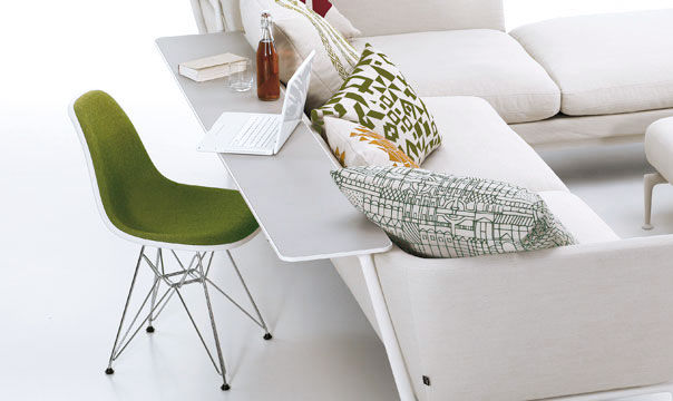 Adding a mounted shelf onto the back of the sofa creates a compact work space—or a spot for snacking. Just don't bump your soda bottle or wine glass...