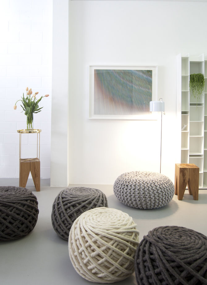 The shop's best-selling 'Urchin Poufs,' by Dutch-based Christien Meindertsma, are knit with gigantic needles. In the foreground are Meindertsma's Texelaar Ottoman Poufs. The wooden Backenzahn stools are by Phillip Mainzer for e15 and the ink-on-paper draw
