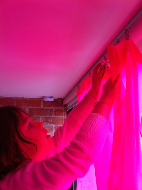 "One of my favorite posts, at least from a visual perspective, is Week 4, in which Taalman details the making of bright pink and bright blue curtains for adjacent bedrooms. ""We started with basic ripstop nylon fabric, a lightweight material used in parachu"