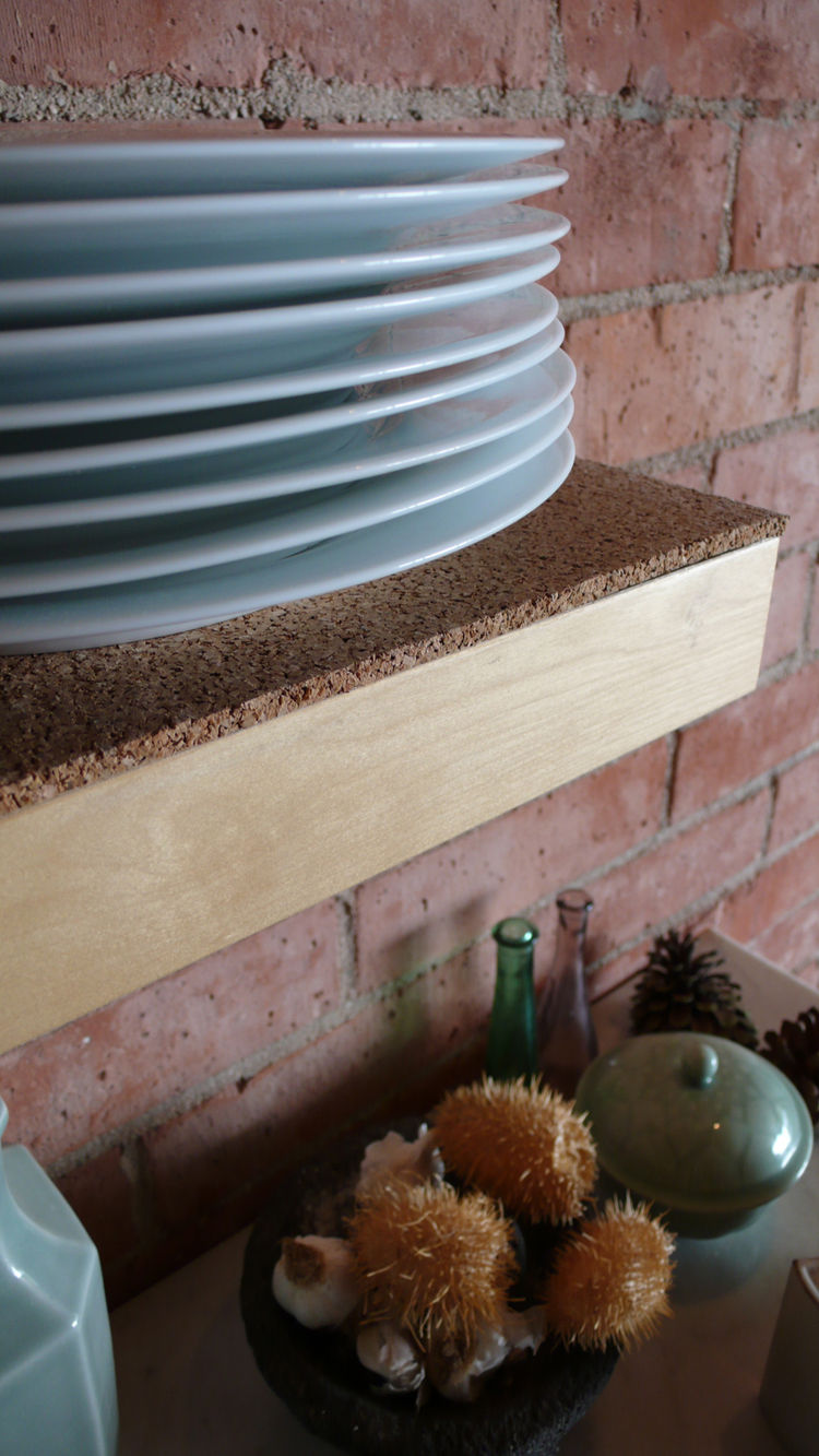 We relined the existing kitchen shelves and drawers with cork sheet material from Linoleum City.