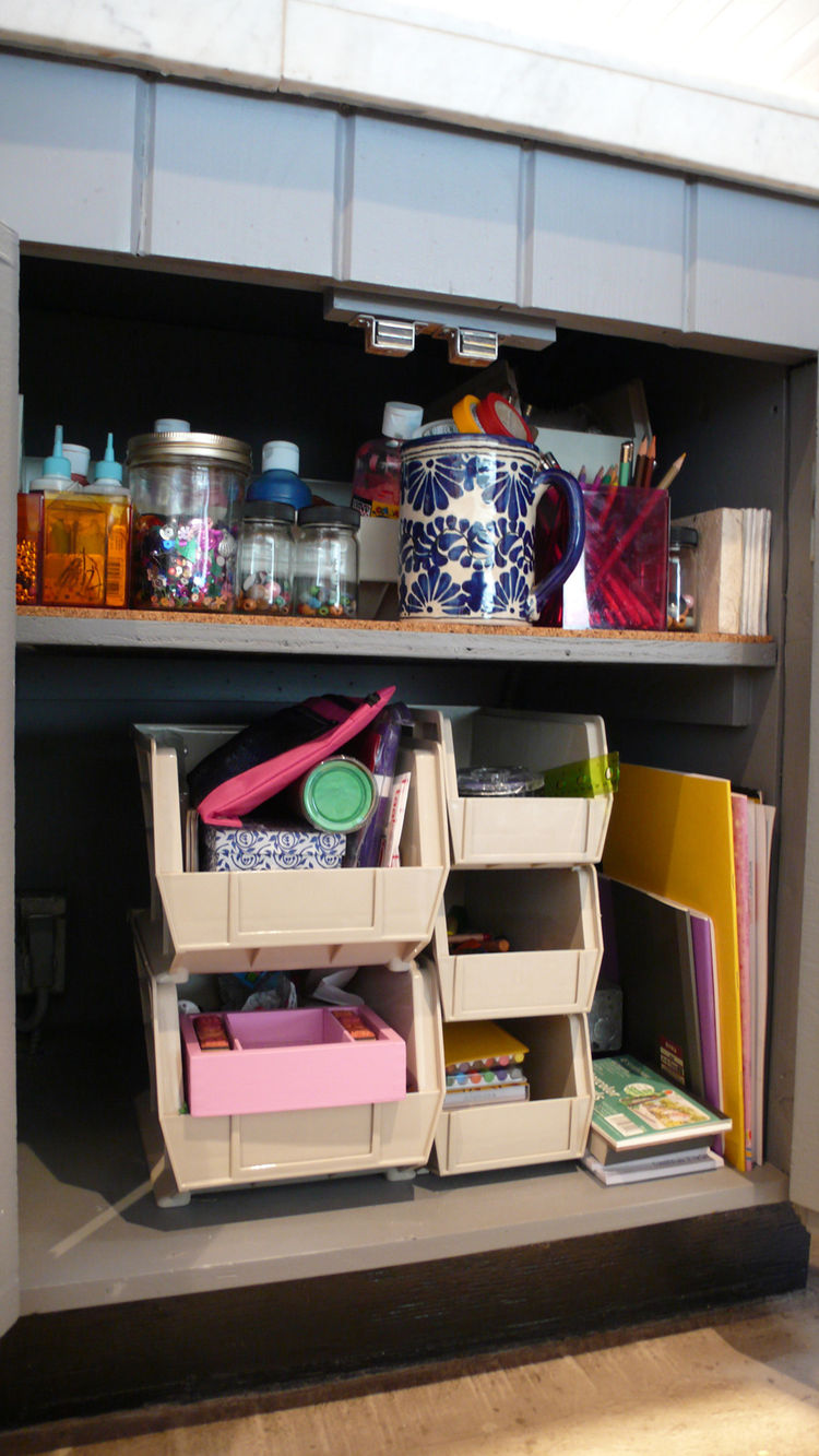 An entire cabinet of the kitchen is dedicated to art materials for our daughter, all arranged for her to reach.