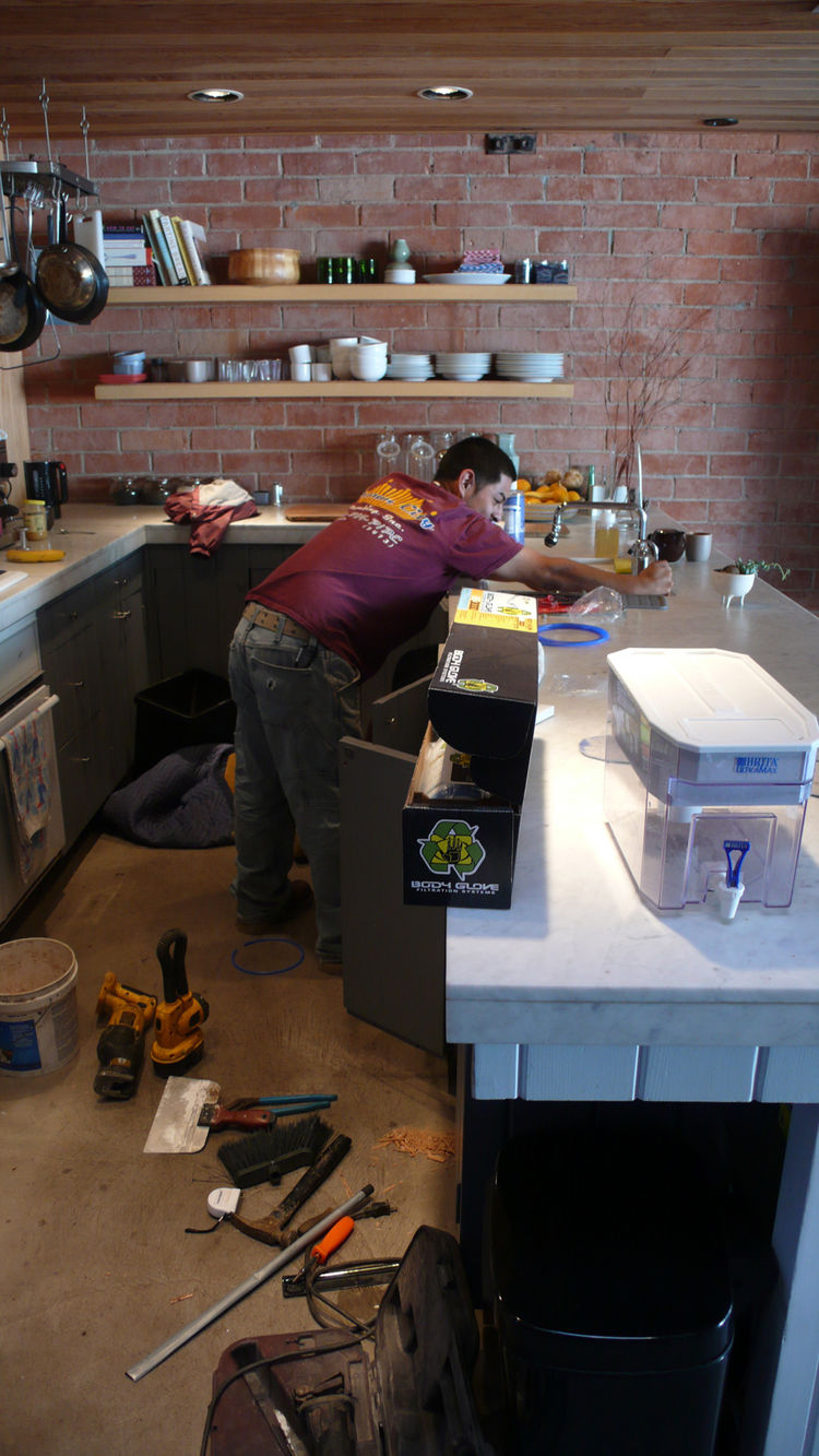 When we installed the Body Glove water filter, we finally got rid of our big Brita that hogged up counter space. Our plumbers also helped install the refurbished Miele dishwasher that we bought off a job site.