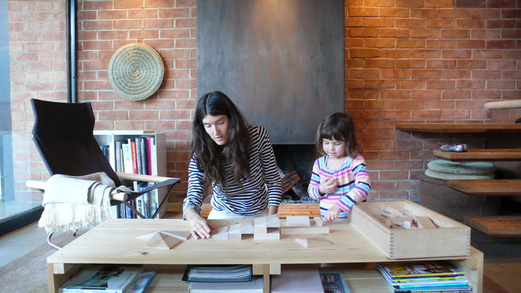 By day the coffee table doubles as a play surface. Our friends David and Diane Glean gave us this great wood block set from the Frank Lloyd Wright foundation that can be used to build the canonical Wright houses. We probably enjoy them as much, if not mor