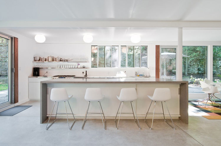 "Depardon and Ogawa inserted a new kitchen and designed its rectilinear island. The dining area had been an enclosed family room, ""and it had, funnily enough, a washer and dryer in it,"" Depardon recalls. ""We all live differently than we did in the fifties."