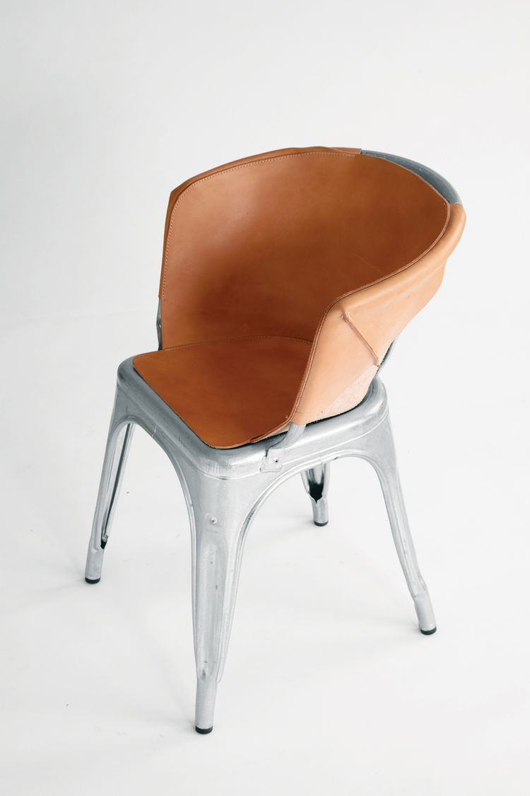 Tolix chair with leather cover by Henry Wilson