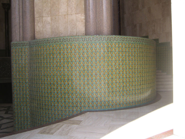 I had a chance to wander around the facade—my visit did not coincide with any of the guided tours, sadly—but the work was spectacular. Again, green is the dominant color as it's the color of Islam (and the star on the Moroccan flag). You absolutely get lo