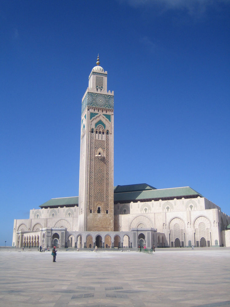 In terms of exterior ornament, the crown has to go to the Hassan II mosque. Built right on the edge of the sea—over the top of what used to be a grand public bath—this mosque was completed in 1993 and was designed by French architect Michel Pinseau for Ki