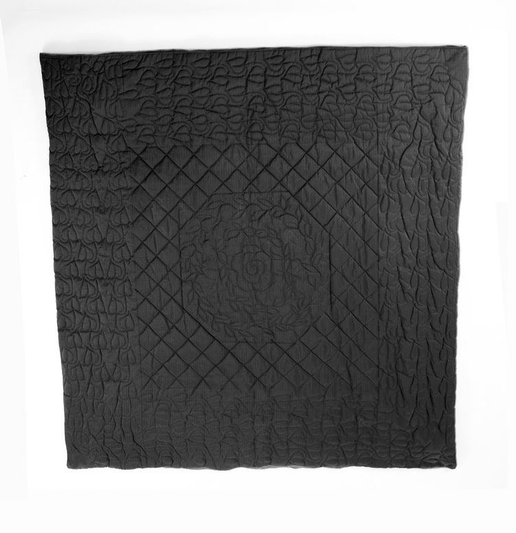 Wong's works grappled with perceptions of safety and security in post-9/11 America. This quilt is made from ballistic nylon, a material typically used in military applications as a protective shield from flying debris. Here, Wong uses the material in a qu