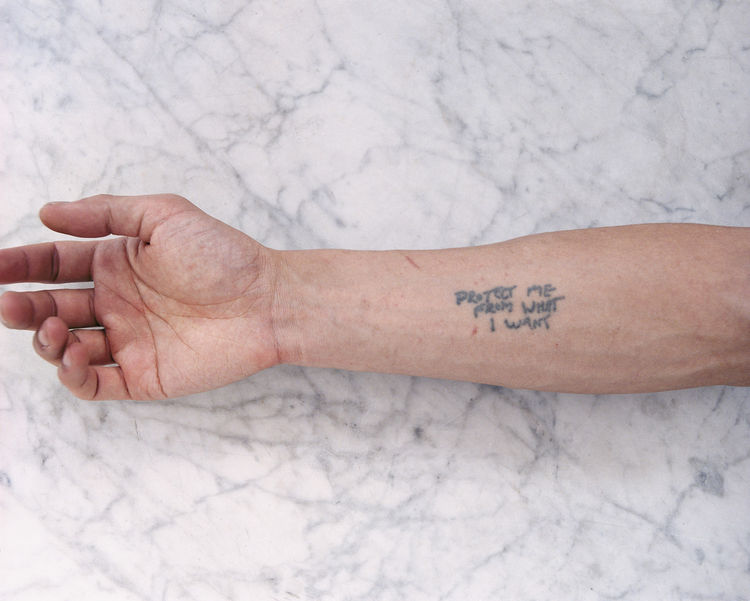 Tobias Wong, <i>Protect Me From What I Want</i>, 2002; artist tattoo; © Estate of Tobias Wong. Photo courtesy SFMOMA.