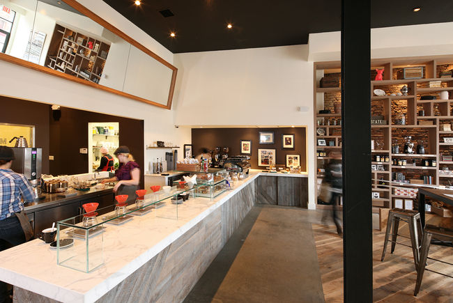 """The marble counter hots a line of single-drip coffee makers and a La Marzocco Strada espresso machine at the far end. They offer <a href=""""http://www.tobysestate.com/shop/coffee/single-origins"""">single-origin beans</a> from Africa and South America, as well"""