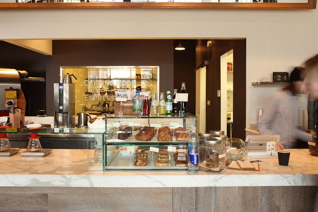 The cafe offers Australian style comfort food with small bites, including a selection of pastries, sandwiches and desserts.