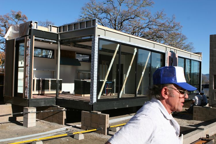 "After the kitchen modules are set in place, the diagonal bracing used during the transportation remains. ""The guy in the foreground worked for Marmol Radziner and had set pre-fabricated buildings all over the world during his career,"" says Bill. ""He was q"