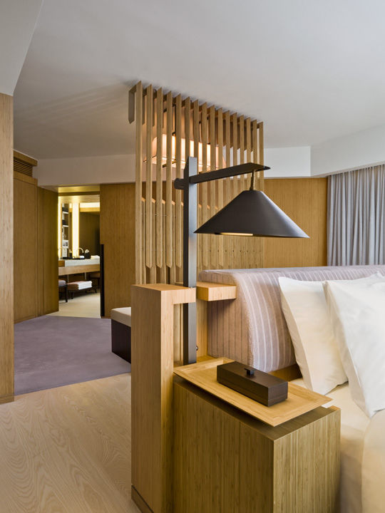 The wooden parasol motif continues in the guestrooms, as evidenced in the interlocking wooden screen behind the bed. Cool in-room perks include bottomless jars of M&Ms and Mentos, organic bath amenities by REN of London, and an iPod Touch that you can use