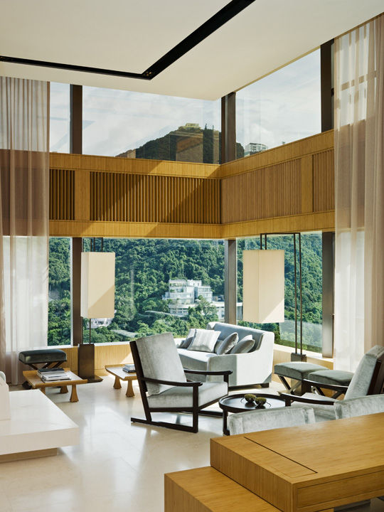 Since the hotel doesn't have a typical lobby, a public 'living room' on the 49th floor serves as a communal gathering place—and, with views of the lush hills nearby, a reminder that notoriously dense and skyscrapered Hong Kong has many faces.