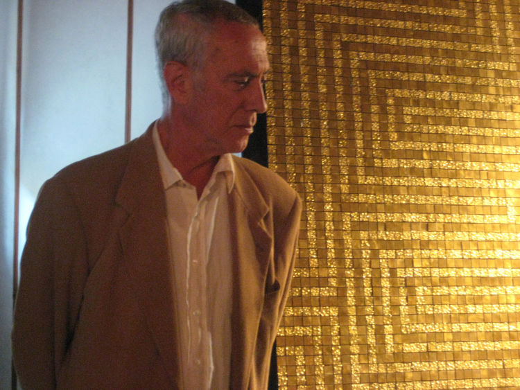 The foundry at Domus Orsoni was opened in 1888 by Angelo Orsoni, and his great-grandson, Lucio, has carried on the family tradition and is now the honorary president. Here, he stands in front of a 24k gold leaf mosaic, and explains how his family foundry
