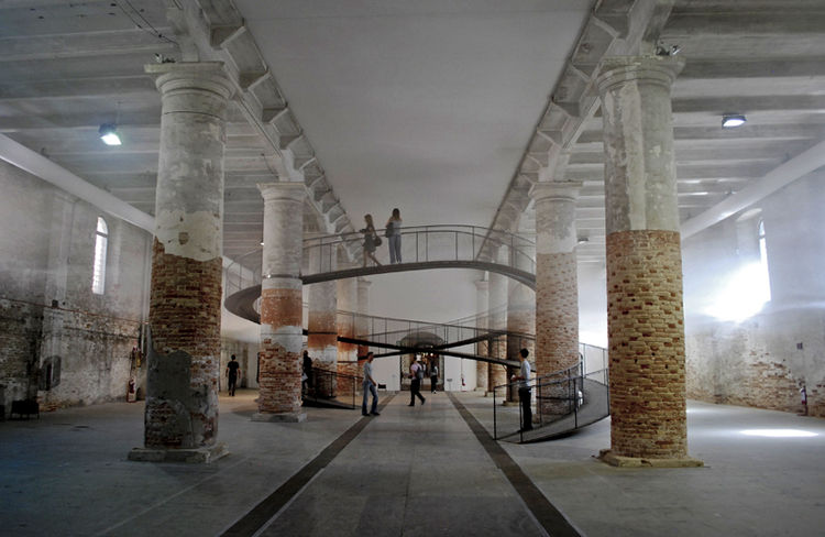 Transsolar + Tetsuo Kondo Architects from Germany created a cloud at building scale by mechanically controlling the heat and humidity at different heights. The path snakes through the cloud and leans against the existing columns for support, allowing peop