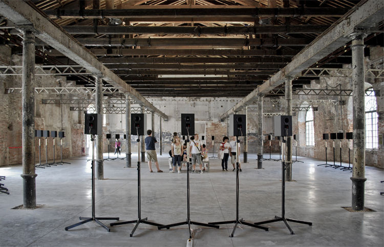 "My favorite exhibit of the Arsenale, ""The Forty Part Motet,"" is quite arguably the least architectural. Artist Janet Cardiff placed 40 speakers strategically around the space in an oval, with each speaker broadcasting the voice of one chorus member. I slo"