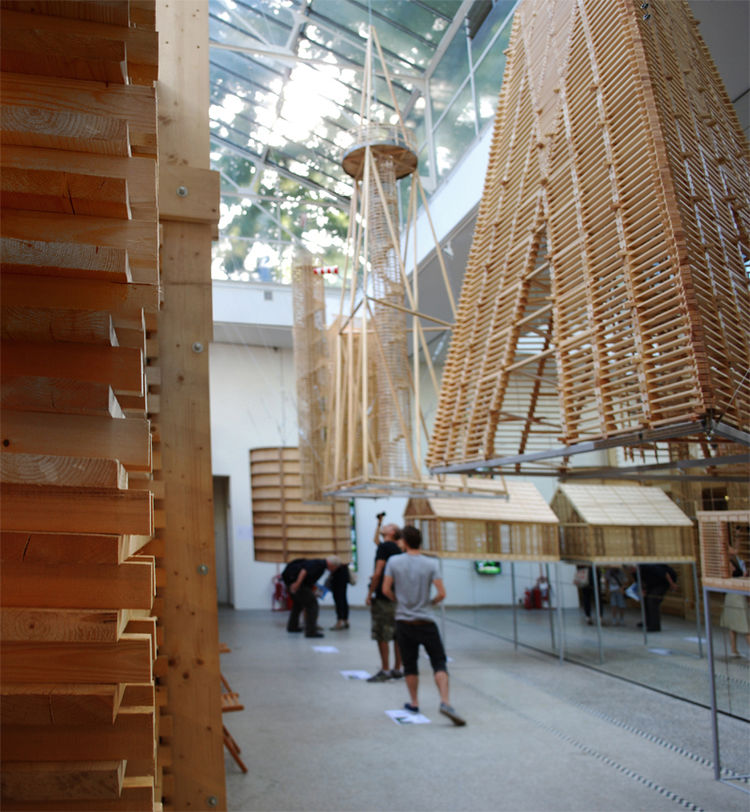 On the other side, a set of sculptural, geometric hangings are suspended from the atrium.