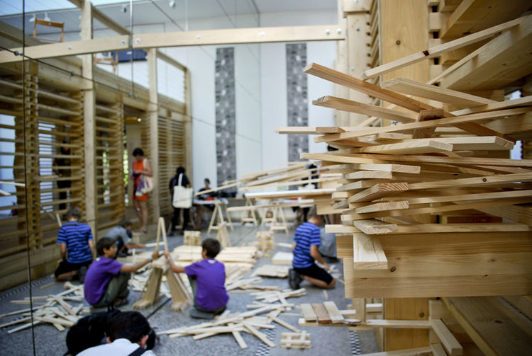 One reason why I enjoyed being here for so long was because it was a continuously morphing exhibit. In a span of a half hour, three teams of children spontaneously formed, which meant three different wooden towers were built and toppled.
