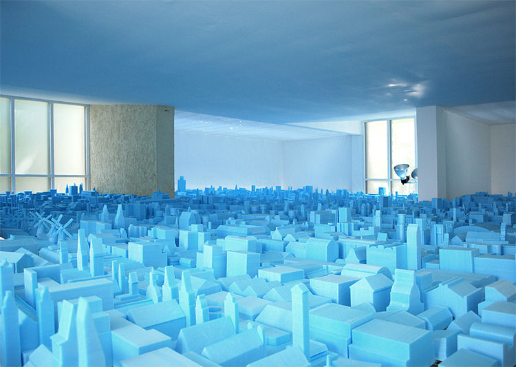 From above and below, the blue foam models of these unused Dutch buildings form a beautiful landscape suspended in mid-air.