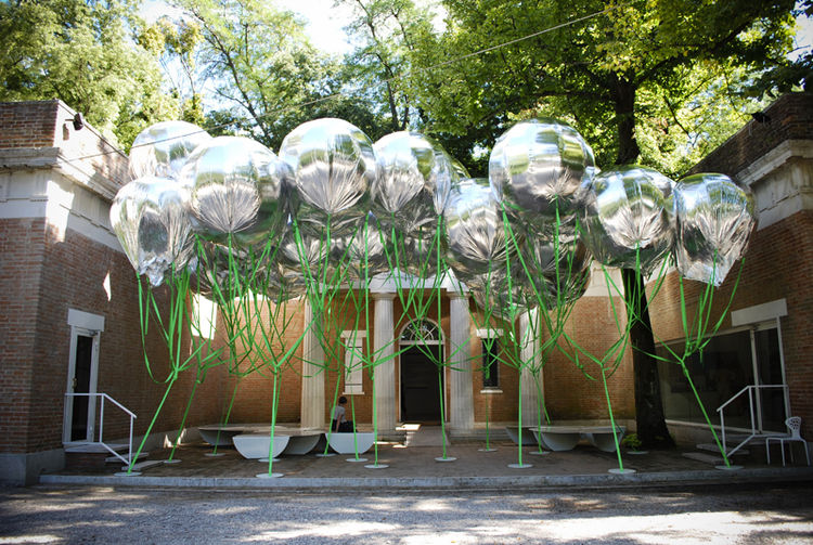 The entrance of the American pavilion was trumpeted by the installation of MOS's Michael Meredith and Hilary Sample -- a silver canopy of 38 helium balloons, made of mylar and partially deflated. Bent steel underneath also serve as benches for this 'porta