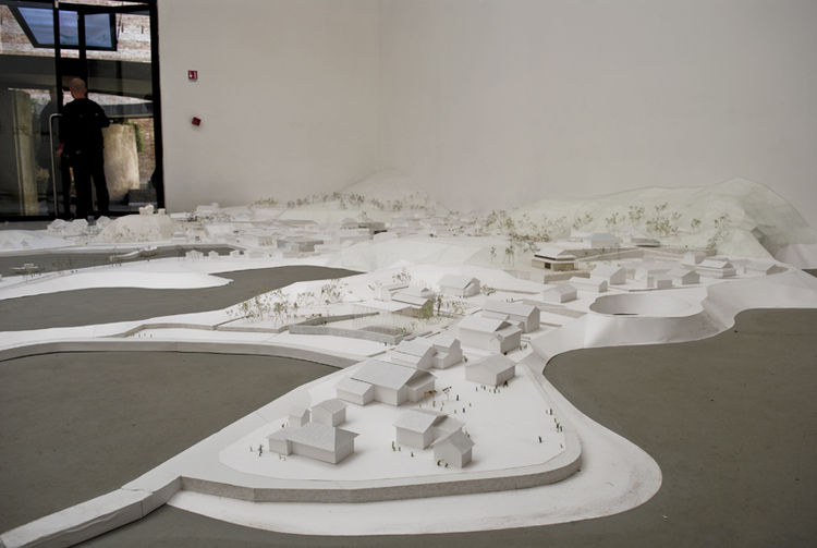 There are regular architectural models, and then there are SANAA's models.  Sprawled out on the floor from wall-to-wall, using only the crispest of white paper, SANAA's rendition of their tear-drop-shaped Teshima Art Museum and the surrounding Seto Inland