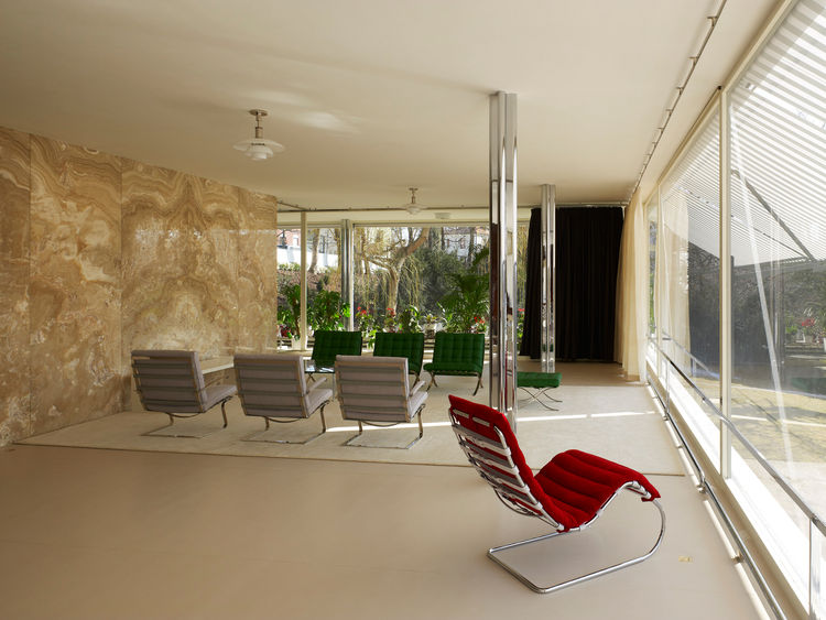 "The furniture pieces are exact copies of the prototypes originally made by Mies. The green chairs are the famed ""Barcelona"" ones while the silver are called ""Tugendhat."" Here you can also Mies design unified the interior furnishings with the exterior deta"