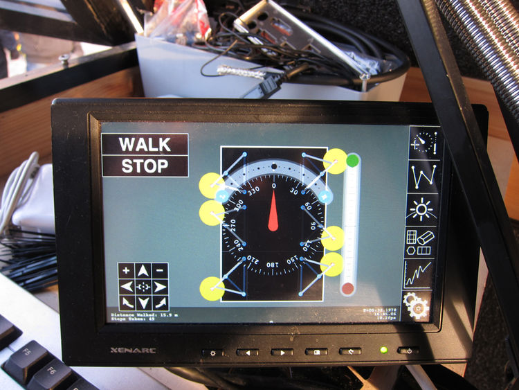 Created with the use of Processing, this is the touchscreen interface with which you can independently control the position of each leg.  As you can see, you can tell it which direction you want it to walk, and how much to turn left or right (with three l