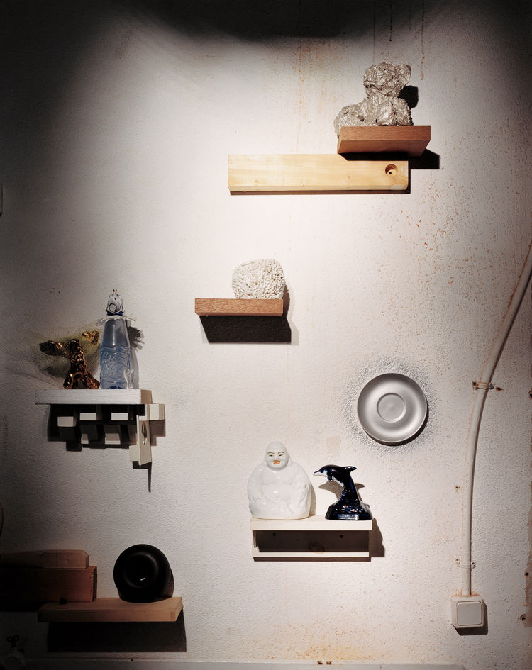 An installation of mismatched handmade shelves makes a display area for another enigmatic assortment of objects, including a Wanders Sponge vase (1997), made by soaking a real sponge in clay, which burns away when the piece is fired. The same technique wa