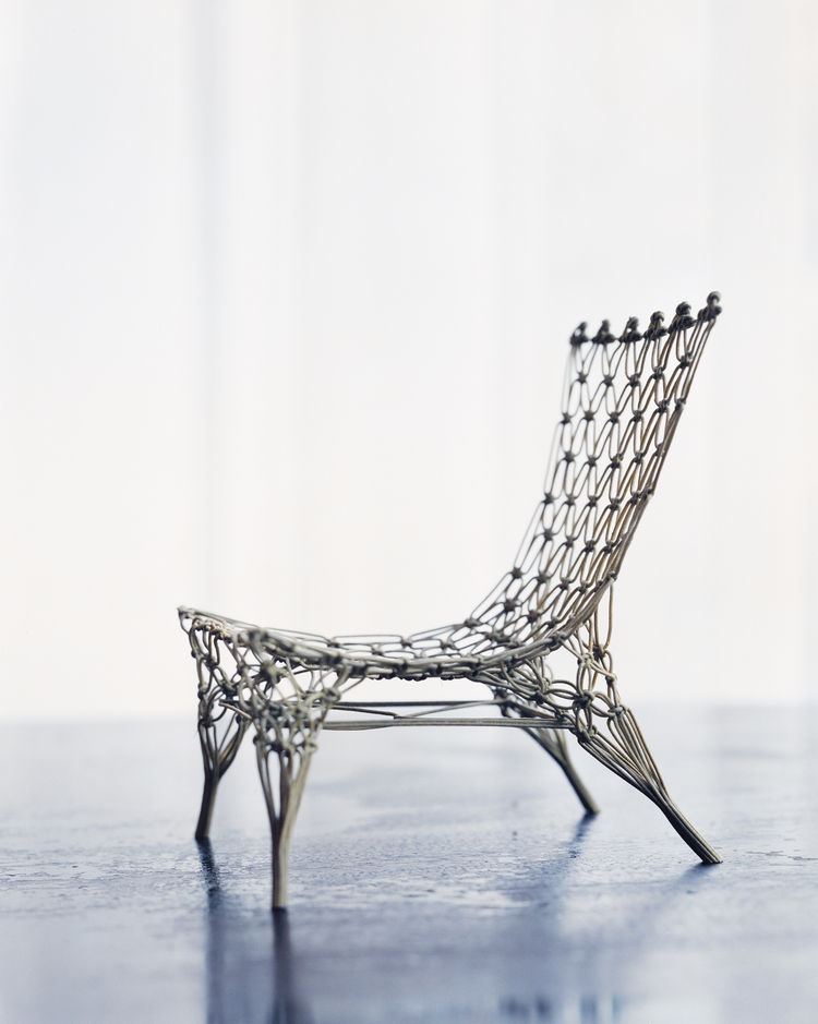 This Knotted chair (1996) is a 1:6 model version, produced by Vitra, and is only a few inches high. Its larger relatives—produced by Cappellini—have already found their way into a number of museum collections.
