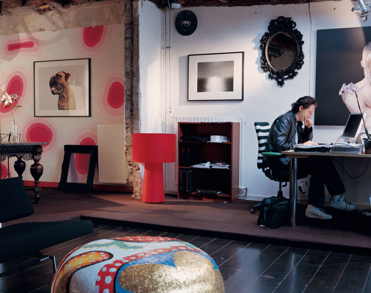 Wanders's home is a combination of past (the pink wall design was painted for his daughter several years ago) and future (the ceiling and some walls were just removed to take the space into a new direction). The dog photo is by Boudewijn Smit; the black-a