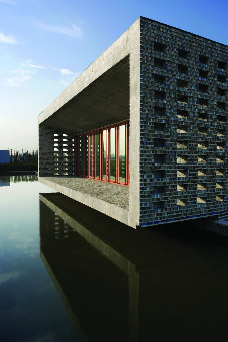 """The Ceramic house in Jinhua, China was built from 2003-2006. Photo by Lv Hengzhong courtesy of Amateur Architecture Studio.<br /><br /><p><em><strong>Don't miss a word of Dwell! Download our </strong></em><a href=""""http://itunes.apple.com/us/app/dwell/id41"""