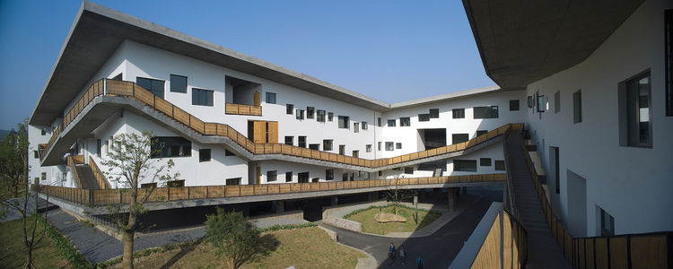 I love the undulating fenestration and slow swoop of the walkways on the Xiangshan Campus at the China Academy of Art in Hangzhou from 2007. Photo by Lv Hengzhou courtesy of Amateur Architecture Studio.