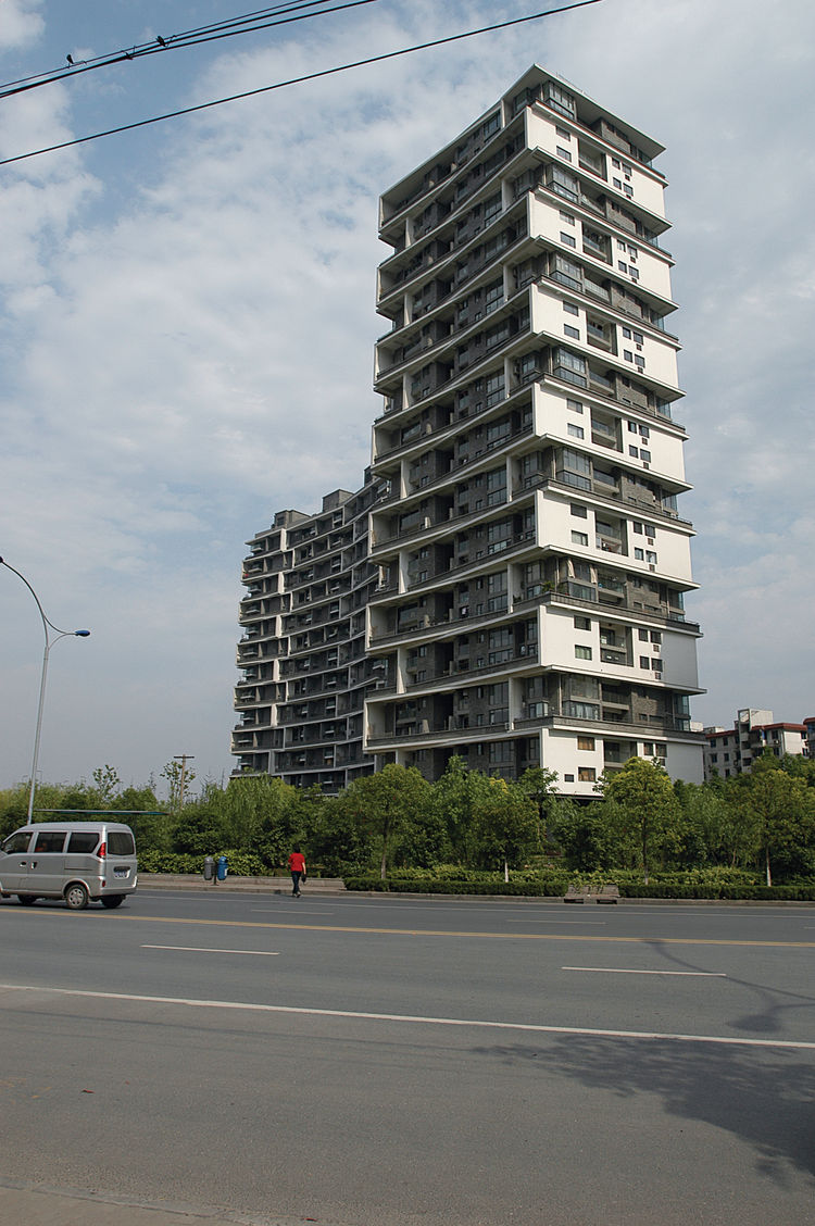 The Vertical Courtyard Apartments were completed in 2007 in Hangzhou, China. Photo by Ly Wenyu courtesy of Amateur Architecture Studio.