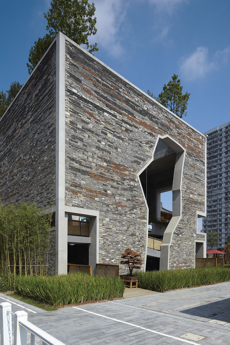 Marrying the rustic feel of stacked stone with some clever engineering, Amateur Architecture Studio's Ningbo Tentou Pavilion from the Shanghai Expo in 2010 cuts a striking figure. Photo by Fu Xing.