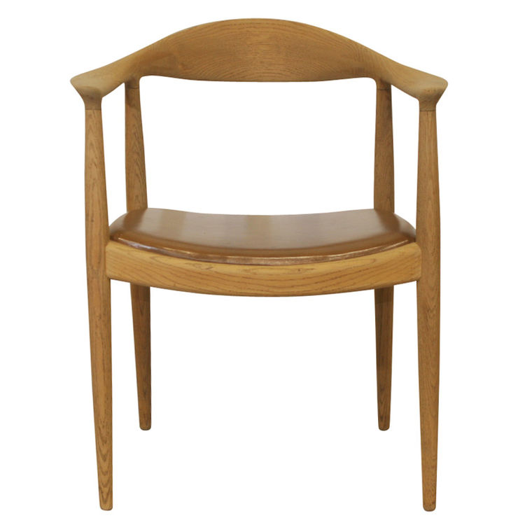 """The Chair"", in oak and tan leather, created by Hans Wegner in 1949."