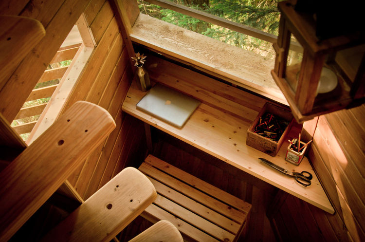 Allen cleverly used the oft-forgotten space behind the stairs as a work area complete with a built-in desk.