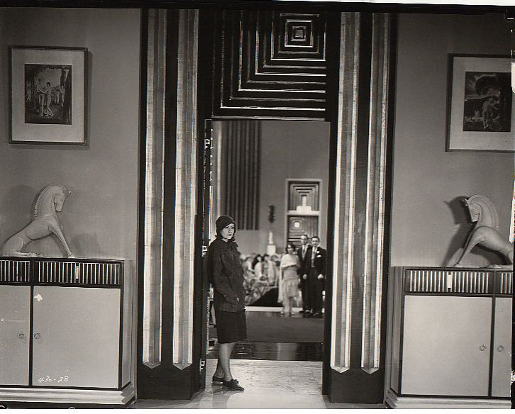 Another Cedric GIbbons set, <em>The Single Standard</em> (1929). Gibbons banished all painted backdrops from his sets, insisting on constructed backgrounds. Eventually the Art Deco aesthetic would morph into Streamline Moderne, a style that incorporated b
