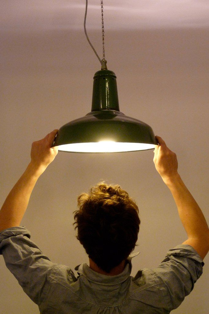 A typical enamel factory lamp is built for the purpose of directing as much light as possible downwards.