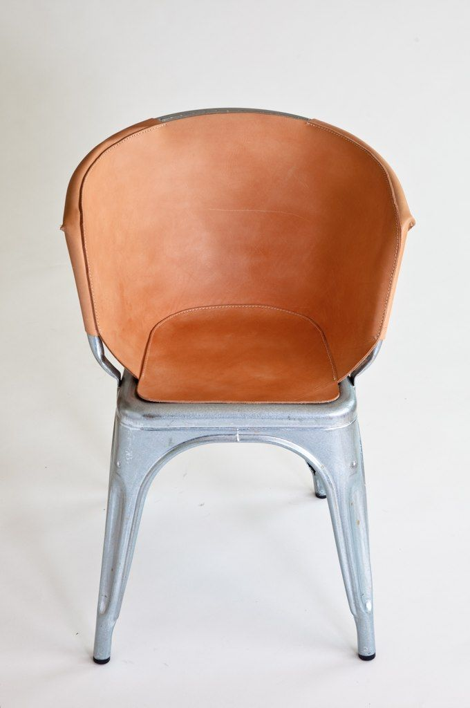 """And here it is spiffed up and softened with a fitted vegetable-tanned leather cover, which will age and patina beautifully over time. """"It reflects and highlights the chairs ingenious method of production, whilst giving it a suitable indoor application,"""" s"""