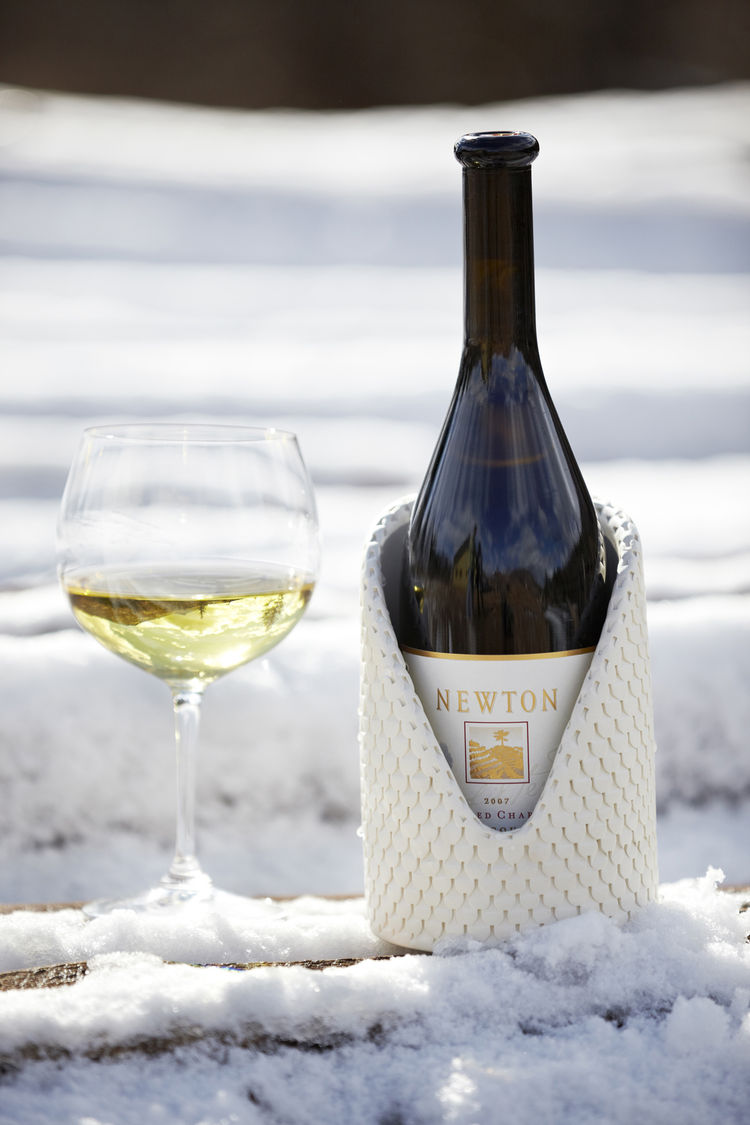 Both the chiller and the wine are placed in a refrigerator for two hours before consumption.  The chiller will keep the wine at optimum temperature throughout dinner.