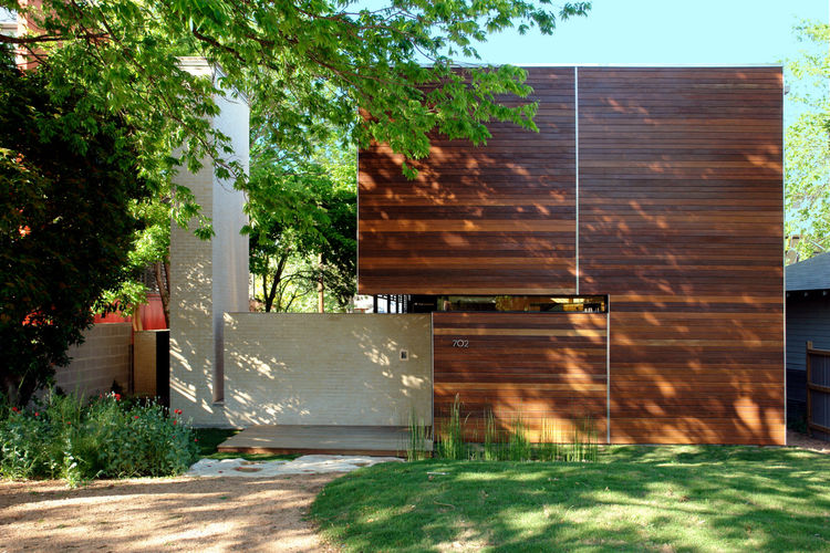 Homeowners Alex Wolfe and Jamie Thorvilson recently moved into the Wolfe Den, which sits on a quiet residential block in Austin. The facade, clad in massarunduba hardwood sourced from a managed forest supplier, strikes a sharp modern chord but still echoe