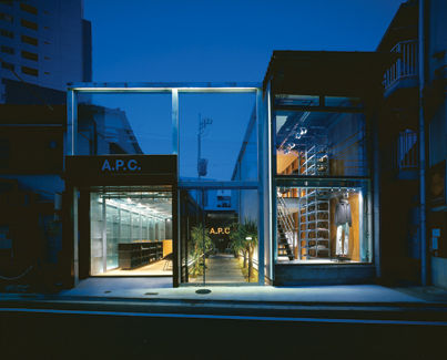For the A.P.C. store in Tokyo, Wonderwall retained the original garage space and framed a new courtyard garden with a steel frame.