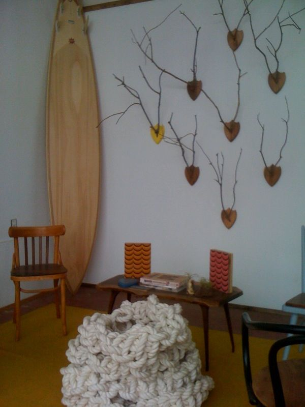 Upon entry, on the left you encounter a display of 'antlers' (made of branches), a wooden surfboard by Danny Hess, and a scattering of creatively refurbished chairs by Duthie, who calls his one-man company Chairtastic.