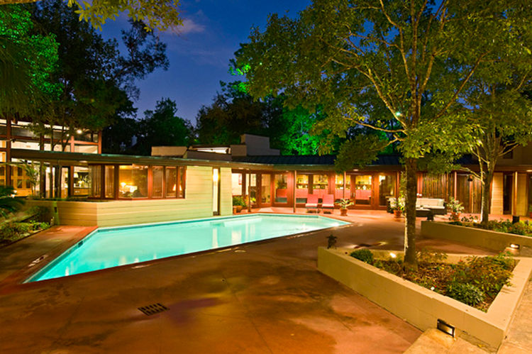 Texan homebuyers are in for a treat: Frank Lloyd Wright's sole Houston home is on the market. This geometric godsend features a windowless front wall, tall panes of glass in back, and Usonian-style bricks. Wright's 1954 original design was a parallelogram